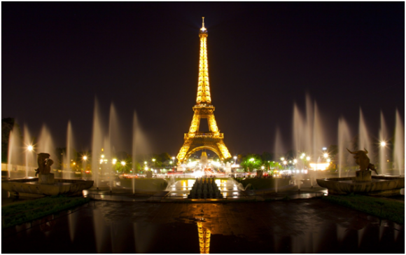 The iconic Eiffel Tower, lit at night (creative commons)